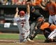 Aug 9, 2014; Baltimore, MD, USA; St. Louis Cardinals left fielder Matt Holliday (7) is out at home plate as Baltimore Orioles catcher Caleb Joseph (36) makes the play in the first inning at Oriole Park at Camden Yards. Mandatory Credit: Joy R. Absalon-USA TODAY Sports