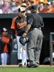 Aug 9, 2014; Baltimore, MD, USA; Baltimore Orioles manager Buck Showalter (26) discusses a call with home plate umpire Laz Diaz during a game against the St. Louis Cardinals at Oriole Park at Camden Yards. Mandatory Credit: Joy R. Absalon-USA TODAY Sports