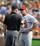 Aug 9, 2014; Baltimore, MD, USA; St. Louis Cardinals manager Mike Matheny (22) discusses a call with third base umpire Jeff Nelson during a game against the Baltimore Orioles at Oriole Park at Camden Yards. Mandatory Credit: Joy R. Absalon-USA TODAY Sports
