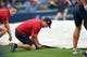 Aug 9, 2014; Atlanta, GA, USA; The grounds crew hurries to place the tarp on the field before the rain hits delaying the game between the Washington Nationals and the  Atlanta Braves at Turner Field. Mandatory Credit: Dale Zanine-USA TODAY Sports