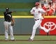 Aug 9, 2014; Cincinnati, OH, USA; Cincinnati Reds right fielder Jay Bruce (32) rounds the bases past Miami Marlins shortstop Adeiny Hechavarria (3) after Bruce hit a solo home run in the first inning at Great American Ball Park. Mandatory Credit: David Kohl-USA TODAY Sports