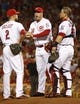 Aug 9, 2014; Cincinnati, OH, USA; Cincinnati Reds manager Bryan Price stands at the mound with shortstop Zack Cozart (2) and catcher Devin Mesoraco (39) in the sixth inning against the Miami Marlins at Great American Ball Park. Mandatory Credit: David Kohl-USA TODAY Sports