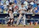 Aug 9, 2014; Kansas City, MO, USA; San Francisco Giants catcher Buster Posey (28) talks with starting pitcher Tim Hudson (17) near home plate after the Kansas City Royals scored in the seventh inning at Kauffman Stadium. The Royals won 5-0. Mandatory Credit: Denny Medley-USA TODAY Sports