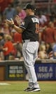 Aug 9, 2014; Cincinnati, OH, USA; Miami Marlins manager Mike Redmond (11) stands on the field after the Marlins defeated the Cincinnati Reds 4-3 at Great American Ball Park. Mandatory Credit: David Kohl-USA TODAY Sports