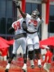 Jul 28, 2014; Tampa, FL, USA; Tampa Bay Buccaneers tackle Demar Dotson (69) and guard Jamon Meredith (79) celebrate during training camp at One Buc Place. Mandatory Credit: Kim Klement-USA TODAY Sports