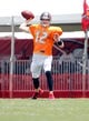 Jul 28, 2014; Tampa, FL, USA; Tampa Bay Buccaneers quarterback Josh McCown (12) throws the ball during training camp at One Buc Place. Mandatory Credit: Kim Klement-USA TODAY Sports