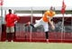 Jul 28, 2014; Tampa, FL, USA; Tampa Bay Buccaneers quarterback Josh McCown (12) throws the ball as head coach Lovie Smith watches during training camp at One Buc Place. Mandatory Credit: Kim Klement-USA TODAY Sports