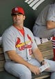 Aug 10, 2014; Baltimore, MD, USA; St. Louis Cardinals manager Mike Matheny (22) in the dugout prior to a game against the Baltimore Orioles at Oriole Park at Camden Yards. Mandatory Credit: Joy R. Absalon-USA TODAY Sports