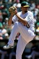 Aug 10, 2014; Oakland, CA, USA; Oakland Athletics starting pitcher Jason Hammel (40) throws to the Minnesota Twins in the first inning of their MLB baseball game at O.co Coliseum. Mandatory Credit: Lance Iversen-USA TODAY Sports
