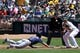 Aug 10, 2014; Oakland, CA, USA;  Minnesota Twins left fielder Jordan Schafer (1) scrambles back to first base after over running the bag in the second inning against the Oakland Athletics at O.co Coliseum. Mandatory Credit: Lance Iversen-USA TODAY Sports