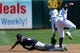 Aug 10, 2014; Oakland, CA, USA; Minnesota Twins left fielder Jordan Schafer (1) safely steals second base in front of Oakland Athletics shortstop Eric Sogard (28) at O.co Coliseum. Twins won 6-1. Mandatory Credit: Lance Iversen-USA TODAY Sports.