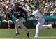 Aug 10, 2014; Oakland, CA, USA; Minnesota Twins third baseman Eduardo Nunez (9) is tagged out between 3rd base and home plate after being caught off base by Oakland Athletics third baseman Josh Donaldson (20) at O.co Coliseum. Twins won 6-1. Mandatory Credit: Lance Iversen-USA TODAY Sports.