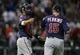 Aug 11, 2014; Houston, TX, USA; Minnesota Twins catcher Kurt Suzuki (8) and relief pitcher Glen Perkins (15) celebrate after defeating the Houston Astros 4-2 at Minute Maid Park. Mandatory Credit: Troy Taormina-USA TODAY Sports