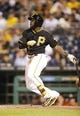 Aug 7, 2014; Pittsburgh, PA, USA; Pittsburgh Pirates right fielder Josh Harrison (5) at bat against the Miami Marlins during the eighth inning at PNC Park. The Pirates won 7-2. Mandatory Credit: Charles LeClaire-USA TODAY Sports