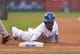 Aug 9, 2014; Kansas City, MO, USA; Kansas City Royals center fielder Jarrod Dyson (1) is brushed back to first base in the seventh inning against the San Francisco Giants at Kauffman Stadium. The Royals won 5-0. Mandatory Credit: Denny Medley-USA TODAY Sports