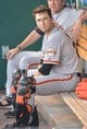 Aug 9, 2014; Kansas City, MO, USA; San Francisco Giants catcher Buster Posey (28) in the dugout early in the game against the Kansas City Royals at Kauffman Stadium. The Royals won 5-0. Mandatory Credit: Denny Medley-USA TODAY Sports