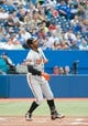 Aug 7, 2014; Toronto, Ontario, CAN; Baltimore Orioles center fielder Adam Jones (10) reacts to a hit in a game against the Toronto Blue Jays at Rogers Centre. The Baltimore Orioles won 2-1. Mandatory Credit: Nick Turchiaro-USA TODAY Sports