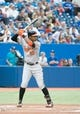 Aug 7, 2014; Toronto, Ontario, CAN; Baltimore Orioles center fielder Adam Jones (10) gets ready to hit in a game against the Toronto Blue Jays at Rogers Centre. The Baltimore Orioles won 2-1. Mandatory Credit: Nick Turchiaro-USA TODAY Sports