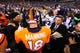 Feb 2, 2014; East Rutherford, NJ, USA; Denver Broncos quarterback Peyton Manning (18) following the game against the Seattle Seahawks in Super Bowl XLVIII at MetLife Stadium.  Mandatory Credit: Mark J. Rebilas-USA TODAY Sports