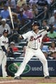 Aug 10, 2014; Atlanta, GA, USA; Atlanta Braves center fielder Emilio Bonifacio (1) is shown during an at bat in their game against the Washington Nationals at Turner Field. The Braves won 3-1. Mandatory Credit: Jason Getz-USA TODAY Sports