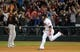 Aug 15, 2014; Cleveland, OH, USA; Cleveland Indians left fielder Mike Aviles (4) hits a game winning home run during the eleventh inning against the Baltimore Orioles at Progressive Field. The Indians won 2-1. Mandatory Credit: Ken Blaze-USA TODAY Sports