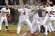 Aug 15, 2014; Cleveland, OH, USA; Cleveland Indians left fielder Mike Aviles (4) celebrates with the rest of the Cleveland Indians after hitting a game wining home run during the eleventh inning against the Baltimore Orioles at Progressive Field. The Indians won 2-1. Mandatory Credit: Ken Blaze-USA TODAY Sports