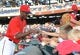 Aug 16, 2014; Washington, DC, USA; Washington Nationals right fielder Michael Taylor (18) signs autographs for fans before the game against the Pittsburgh Pirates at Nationals Park. Mandatory Credit: Brad Mills-USA TODAY Sports