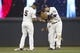 Aug 16, 2014; Minneapolis, MN, USA; Minnesota Twins second baseman Brian Dozier (2) celebrates with shortstop Eduardo Escobar (5) after defeating the Kansas City Royals at Target Field. The Twins won 4-1. Mandatory Credit: Jesse Johnson-USA TODAY Sports