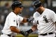 Aug 19, 2014; Chicago, IL, USA; Chicago White Sox first baseman Jose Abreu (79) reacts with designated hitter Adam Dunn (44) after hitting a home run against Baltimore Orioles starting pitcher Chris Tillman (not pictured) during the first inning at U.S Cellular Field. Mandatory Credit: Mike DiNovo-USA TODAY Sports