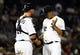 Aug 19, 2014; Chicago, IL, USA; Chicago White Sox catcher Tyler Flowers (21) talks with starting pitcher Jose Quintana (62) during the sixth inning at U.S Cellular Field. Mandatory Credit: Mike DiNovo-USA TODAY Sports