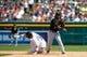 Aug 14, 2014; Detroit, MI, USA; Pittsburgh Pirates second baseman Michael Martinez (3) makes a throw to first as Detroit Tigers third baseman Nick Castellanos (9) slides into second at Comerica Park. Mandatory Credit: Rick Osentoski-USA TODAY Sports