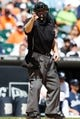 Aug 14, 2014; Detroit, MI, USA; MLB umpire Ted Barrett calls a strike during the game between the Detroit Tigers and the Pittsburgh Pirates at Comerica Park. Mandatory Credit: Rick Osentoski-USA TODAY Sports