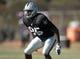 Aug 12, 2014; Oxnard, CA, USA; Oakland Raiders linebacker Kaelin Burnett (95) at scrimmage against the Dallas Cowboys at River Ridge Fields. Mandatory Credit: Kirby Lee-USA TODAY Sports