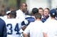 Aug 12, 2014; Oxnard, CA, USA; Magic Johnson (center) talks with Dallas Cowboys at scrimmage against the Oakland Raiders at River Ridge Fields. Mandatory Credit: Kirby Lee-USA TODAY Sports