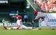 Aug 20, 2014; St. Louis, MO, USA; St. Louis Cardinals third baseman Matt Carpenter (13) slides safely past Cincinnati Reds shortstop Zack Cozart (2) for a double during the first inning at Busch Stadium. Mandatory Credit: Jeff Curry-USA TODAY Sports