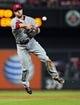 Aug 20, 2014; St. Louis, MO, USA; Cincinnati Reds shortstop Zack Cozart (2) throws on the run to get St. Louis Cardinals third baseman Matt Carpenter (not pictured) during the fifth inning at Busch Stadium. Mandatory Credit: Jeff Curry-USA TODAY Sports