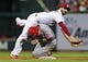 Aug 20, 2014; St. Louis, MO, USA; St. Louis Cardinals second baseman Daniel Descalso (33) falls onto Cincinnati Reds shortstop Zack Cozart (2) to complete the double play during the fifth inning at Busch Stadium. Mandatory Credit: Jeff Curry-USA TODAY Sports