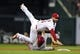 Aug 20, 2014; St. Louis, MO, USA; St. Louis Cardinals second baseman Daniel Descalso (33) leaps over Cincinnati Reds third baseman Ramon Santiago (7) but is unable to complete the double play during the fifth inning at Busch Stadium. Mandatory Credit: Jeff Curry-USA TODAY Sports