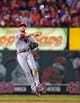 Aug 20, 2014; St. Louis, MO, USA; Cincinnati Reds shortstop Zack Cozart (2) leaps and throws but is unable to get St. Louis Cardinals center fielder Jon Jay (not pictured) during the fifth inning at Busch Stadium. Mandatory Credit: Jeff Curry-USA TODAY Sports