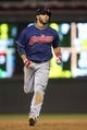 Aug 20, 2014; Minneapolis, MN, USA; Cleveland Indians third baseman Mike Aviles (4) rounds second base after hitting a home run in the ninth inning against the Minnesota Twins at Target Field. The Indians won 5-0. Mandatory Credit: Jesse Johnson-USA TODAY Sports