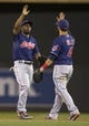 Aug 20, 2014; Minneapolis, MN, USA; Cleveland Indians center fielder Michael Bourn (24) celebrates with Cleveland Indians third baseman Mike Aviles (4) after beating the Minnesota Twins at Target Field. The Indians won 5-0. Mandatory Credit: Jesse Johnson-USA TODAY Sports