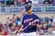 Aug 19, 2014; Minneapolis, MN, USA; Minnesota Twins first baseman Joe Mauer (7) looks at his bat against the Cleveland Indians at Target Field. Mandatory Credit: Brad Rempel-USA TODAY Sports