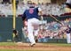 Aug 21, 2014; Minneapolis, MN, USA; Minnesota Twins catcher Kurt Suzuki (8) runs to first in the against the Cleveland Indians at Target Field. Mandatory Credit: Brad Rempel-USA TODAY Sports