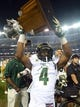 Aug 29, 2014; Denver, CO, USA; Colorado State Rams wide receiver Charles Lovett (4) holds the Centennial Cup following the win over the Colorado Buffaloes at Sports Authority Field at Mile High. Mandatory Credit: Ron Chenoy-USA TODAY Sports
