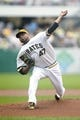 Aug 31, 2014; Pittsburgh, PA, USA; Pittsburgh Pirates starting pitcher Francisco Liriano (47) delivers a pitch against the Cincinnati Reds during the first inning at PNC Park. Mandatory Credit: Charles LeClaire-USA TODAY Sports