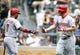 Aug 31, 2014; Pittsburgh, PA, USA; Cincinnati Reds shortstop Ramon Santiago (7) high-fives right fielder Chris Heisey (28) after Heisey hit a two run home run against the Pittsburgh Pirates during the fifth inning at PNC Park. The Reds won 3-2. Mandatory Credit: Charles LeClaire-USA TODAY Sports