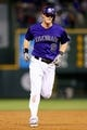 Sep 2, 2014; Denver, CO, USA; Colorado Rockies second baseman DJ LeMahieu (9) rounds the bases after hitting a two run home run in the third inning against the San Francisco Giants at Coors Field. Mandatory Credit: Isaiah J. Downing-USA TODAY Sports