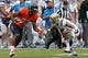 Aug 30, 2014; Charlottesville, VA, USA; Virginia Cavaliers wide receiver Kyle Dockins (87) runs with the ball as UCLA Bruins defensive back Priest Willis (15) attempts the tackle at Scott Stadium. Mandatory Credit: Geoff Burke-USA TODAY Sports
