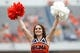 Aug 30, 2014; Charlottesville, VA, USA; A Virginia Cavaliers cheerleader cheers on the sidelines against the UCLA Bruins at Scott Stadium. Mandatory Credit: Geoff Burke-USA TODAY Sports