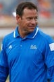 Aug 30, 2014; Charlottesville, VA, USA; UCLA Bruins head coach Jim Mora stands on the field during warm ups prior to the Bruins' game against the Virginia Cavaliers at Scott Stadium. Mandatory Credit: Geoff Burke-USA TODAY Sports